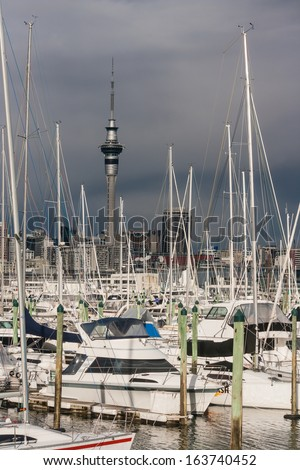 Auckland harbour with Sky Tower at storm - stock photo