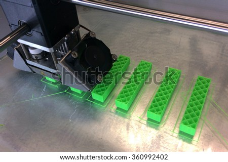 AUCKLAND -  JAN 09 2016: 3D printing machine at work.One of the greatest benefits of 3D printing has been experienced through its facilitation of organ transplants in the medical field. - stock photo