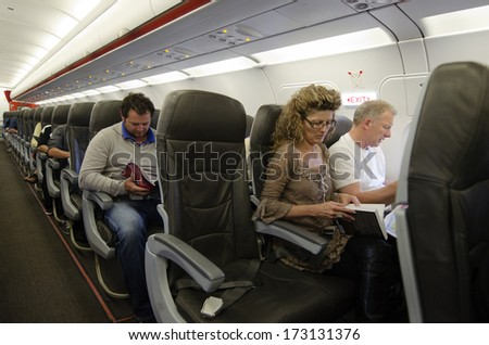 AUCKLAND - JAN 12: Interior of airplane with passengers on seats on Jan 12 2013.The annual risk of being killed in a plane crash  is 1 in 11 million. - stock photo
