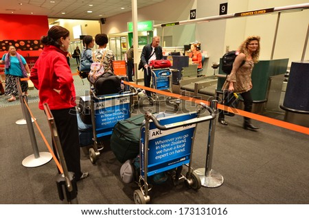 AUCKLAND - JAN 12:Passengers waiting to check-in at Auckland Airport on Jan 12 2014.60% of people check-in through the airline�¢??s main counter, which takes an average of 19 minutes. - stock photo