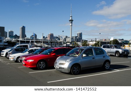 AUCKLAND - JUNE 02:Cars in a parking lot on June 02 2013.There is a growing shortage of car park spaces in the Auckland CBD. Approximately 800 car parks have gone since 2007. - stock photo