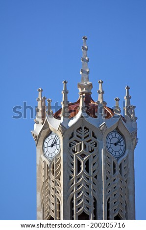 AUCKLAND - MAY 31 2014 2014:The clock tower of the old arts and commerce building at the University of Auckland.It's historic place (1926), considered an Auckland landmark and icon of the university. - stock photo