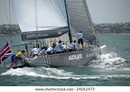 AUCKLAND, NEW ZEALAND - 30 JANUARY - 14 FEBRUARY, 2009: Louis Vuitton Pacific Series sees Americas Cup rival teams match race one another in other teams boats. Shown here is UK's Origin in USA Oracle's yacht practice - stock photo