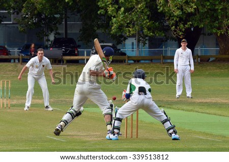 AUCKLAND - NOV 14 2015:Cricket bowler bowling to a batsman..It's one of New Zealand most popular national sport and the first recorded game took place in Wellington in December 1842. - stock photo