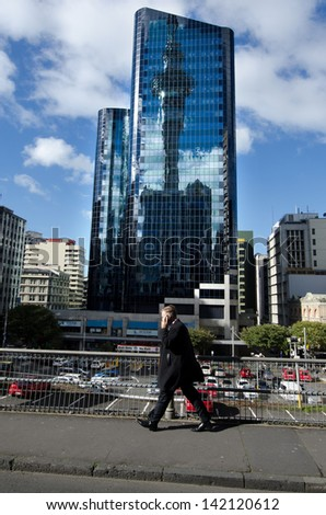 AUCKLAND, NZ - MAY 27:Businessman talks on his mobile phone on May 27 2013. 36% of NZ men working full-time worked 50 or more hours.