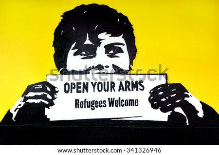 "AUCKLAND, NZL - NOV 20 2015: Graffiti with the political slogan ""Refugees Welcome"".Each year New Zealand accepts 750 refugees as agreement with the United Nations High Commissioner for Refugees. - stock photo"