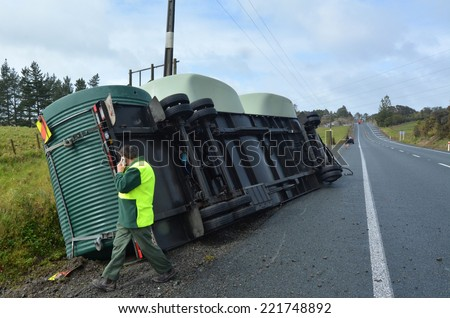 AUCKLAND , NZL - SEP 22 2014: Truck accident during high winds storm in New Zealand.Truck companies require to advise their truck drivers to use extreme caution when driving under adverse conditions. - stock photo