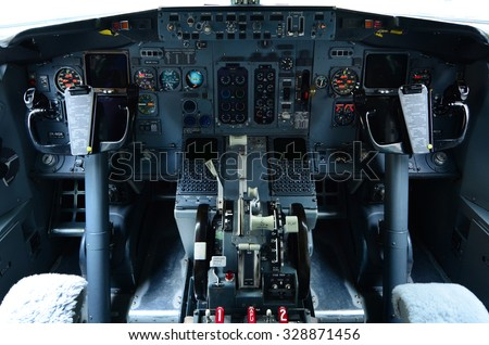 AUCKLAND - OCT 18 2015:Boeing 737 cockpit.It's the best-selling jet commercial airliner, continuously manufactured since 1967 with 8,725 aircraft delivered and 4,243 orders as of September 2015. - stock photo