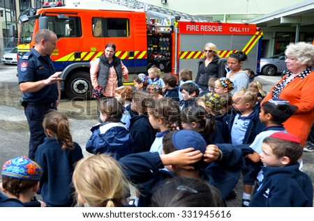 AUCKLAND  - OCT 27 2015:Fire Safety Education day in Auckland City Fire Station, New Zealand.Each year over 20,000 fires are attended by New Zealand Fire Service, including nearly 5,000 house fires. - stock photo