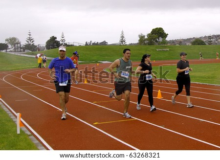 AUCKLAND- Oct. 17: Participants in the Sir Barry Curtis 10K Classic run sprint to the finish line on sunday Oct. 17,2010 at Pakuranga, Auckland, New Zealand - stock photo