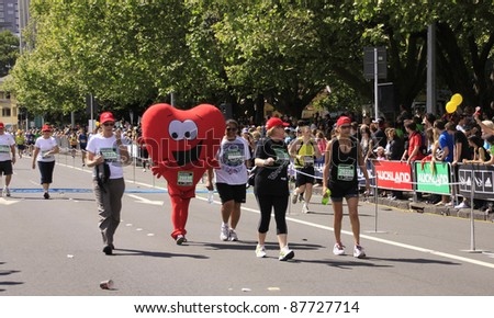 AUCKLAND- OCT. 30: Unidentified participant in Auckland marathon in heart costume walk too the finish line on Sunday Oct. 30,2011 in  Auckland, New Zealand - stock photo