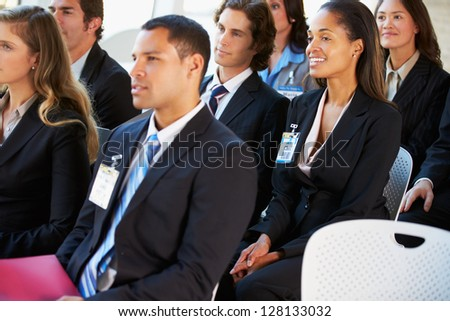 Audience Listening To Presentation At Conference