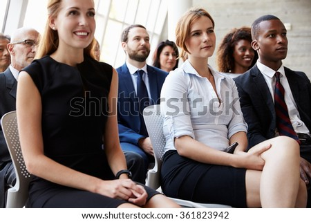 Audience Listening To Speaker At Business Conference - stock photo