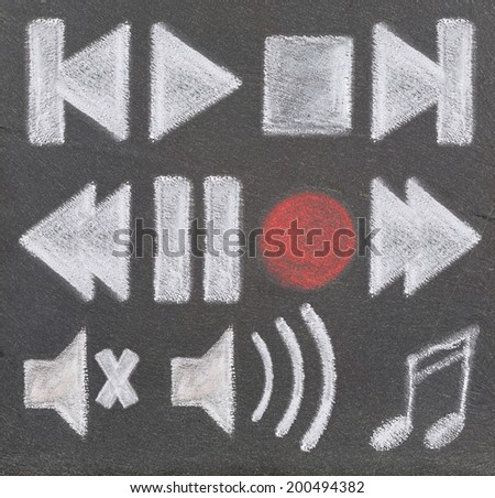 Audio and video icons, drawn with chalke on a plate of slate. - stock photo