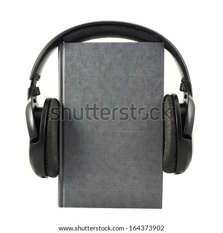 Audio-book concept composition as a book with a headphones on it, isolated over white background - stock photo