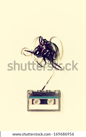 Audio cassette tape with subtracted out tape. vintage effect. top view - stock photo