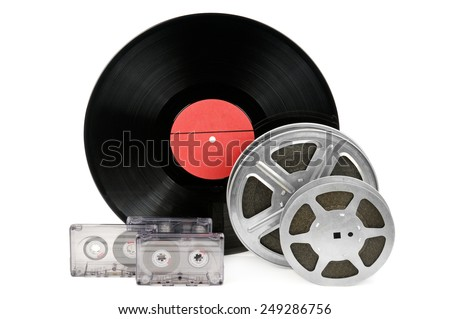 audio cassettes, records and film strip isolated on white background - stock photo