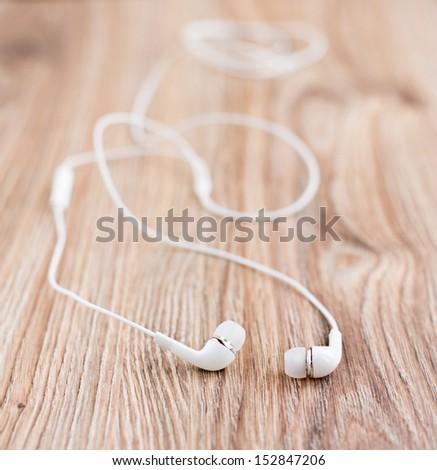 Audio earphones on a table - stock photo