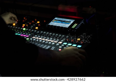 Audio mixer mixing board fader and knobs, Music mixing console  - stock photo