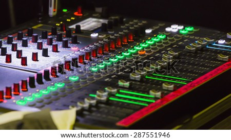 Audio mixer mixing board fader and knobs, Music mixing console with backlit buttons