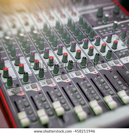 audio mixer, music equipment. recording studio gears, broadcasting tools, mixer, synthesizer. shallow dept of field for music background - stock photo