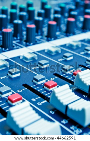 audio mixer with shallow depth of field - blue toned