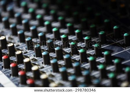 Audio mixing console closeup - stock photo