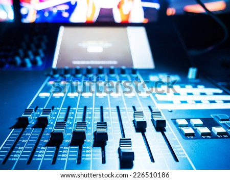 audio sound mixer with buttons and sliders . A little of DOF.  - stock photo