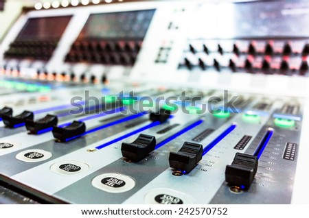 audio sound mixer with buttons and sliders. A little of DOF. - stock photo