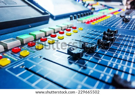 Audio sound mixer with buttons and sliders . A little of DOF. Selective focus. - stock photo