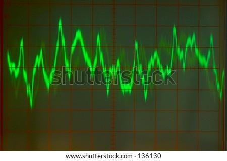 Audio wave form on oscilloscope screen. - stock photo