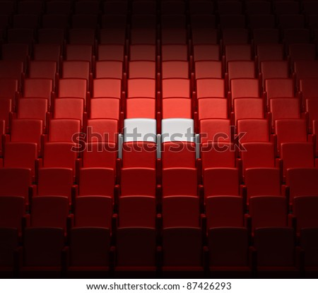 auditorium with two reserved seats - stock photo
