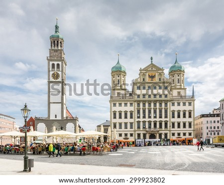 AUGSBURG, GERMANY - APRIL 11: Tourists at the Rathausplatz in Augsburg, Germany on April 11, 2015. Augsburg is one of the oldest cities of Germany.