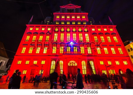 AUGSBURG, GERMANY - JUNE 20, 2015: The beautiful town hall of Augsburg is illuminated in red at night during the festival 'the long night of lights' in Augsburg, Germany. Augsburg is an ancient roman - stock photo