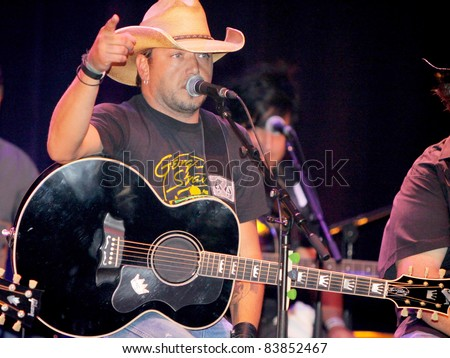 "August 16, 2011 - Athens, GA - Jason Aldean. Country artist Colt Ford rounded up his friends to hold a benefit for the family of Elmer ""Buddy"" Christian. - stock photo"