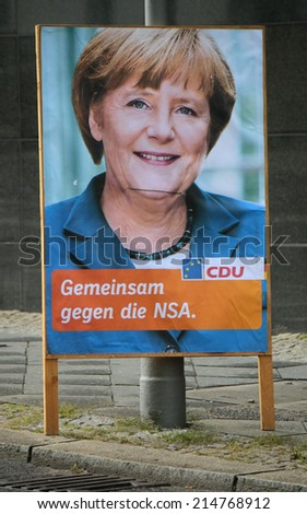 "AUGUST 30, 2014 - BERLIN: a fake election poster showing Chancellor Angela Merkel wthe the slogan ""Gemeinsam gegen die NSA"" (United against the NSA), demonstration against surveillance. - stock photo"
