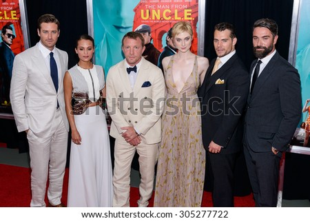 "August 10, 2015, New York, USA - Armie Hammer, Alicia Vikander, Guy Ritchie, Elizabeth Debicki, and Henry Cavill attend the New York City premiere of ""The Man From U.N.C.L.E."" at the Ziegfeld Theater - stock photo"