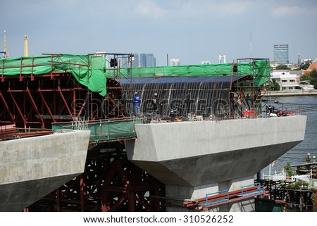 AUGUST 9, 2015 ; NONTHABURI - THAILAND : Detail construction of Concrete bridge across Chaopraya river under-construction of its foundation, road surface and its supporting structure.