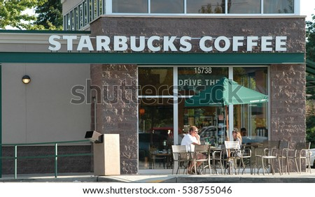 AUGUST 4, 2007. REDMOND, WA. CIRCA: Starbucks coffee store with people drinking coffee outside in Redmond, Wa.