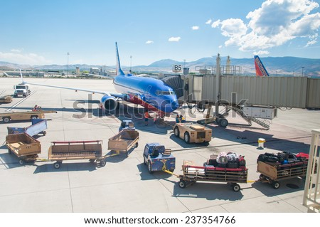 AUGUST 21. 2011- SALT LAKE CITY, UT: Delta Airlines Airplane in tarmac ready to be boarded by flying passengers and crew - stock photo