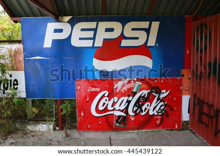 "AUGUST 2015 - SZCZECIN, POLAND: the logo of the brands ""Coca Ciola"" and ""Pepsi Cola""."