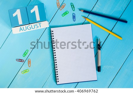 August 11th. Image of august 11 wooden color calendar on blue background. Summer day. Empty space for text - stock photo