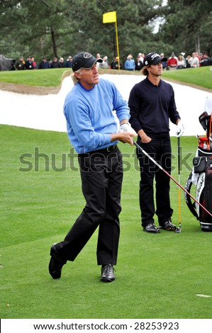 AUGUSTA, GA - APR 7: Greg Norman and Adam Scott at 2009 Masters golf tournament in Augusta, GA on April 7, 2009.