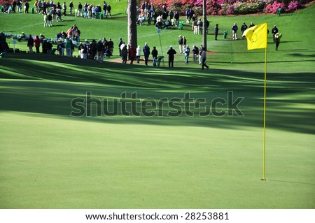 Augusta, Ga. - April 7: Flag on green at the 2009 Masters golf tournament. - stock photo