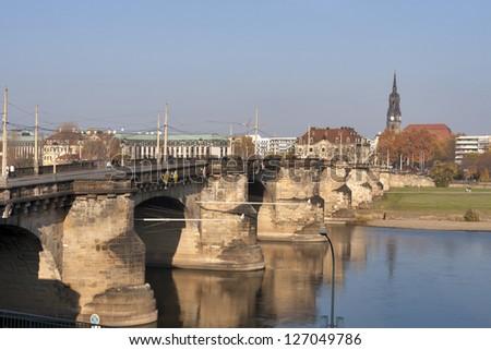 Augustus Bridge with unrecognized pedestrians in Dresden, Germany. It is the oldest bridge in the city of Dresden,  it was built between in 1907-1910. - stock photo