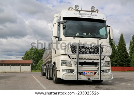 AURA, FINLAND - JUNE 20, 2014: White Man TGX 26.540 tank truck with bull bar parked on a yard. MAN ranks among the most sustainable vehicle and engineering companies worldwide. - stock photo