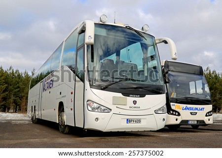 AURA, FINLAND - MARCH 1; 2015: White Scania Irizar coach bus and VDL Citea parked. The coach vehicle body manufacturer Irizar works especially closely with Scania. - stock photo