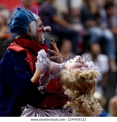 AURILLAC, FRANCE-AUGUST 22: actor holding an unconscious actress as part of the Aurillac International Street Theater Festival, cie teatro del silencio ,on august 22, 2014, in Aurillac,France.  - stock photo