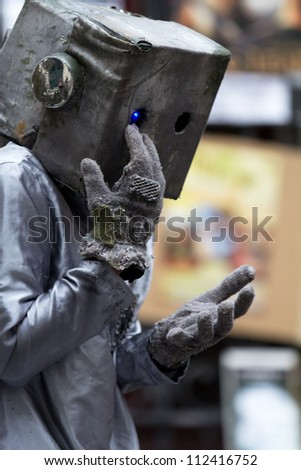 AURILLAC, FRANCE - AUGUST 24: an actor is playing as a kind robot as part of the Aurillac International Street Theater Festival, show Robot Nozomi, on august 24, 2012, in Aurillac,France. - stock photo