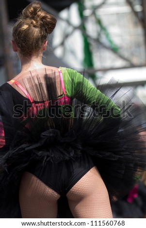 AURILLAC, FRANCE - AUGUST 22 : Dancer , from the back, as part of the Aurillac International Street Theater Festival, show by the Ballets Temps Dance Jr Cie , on august 22, 2012, in Aurillac,France.